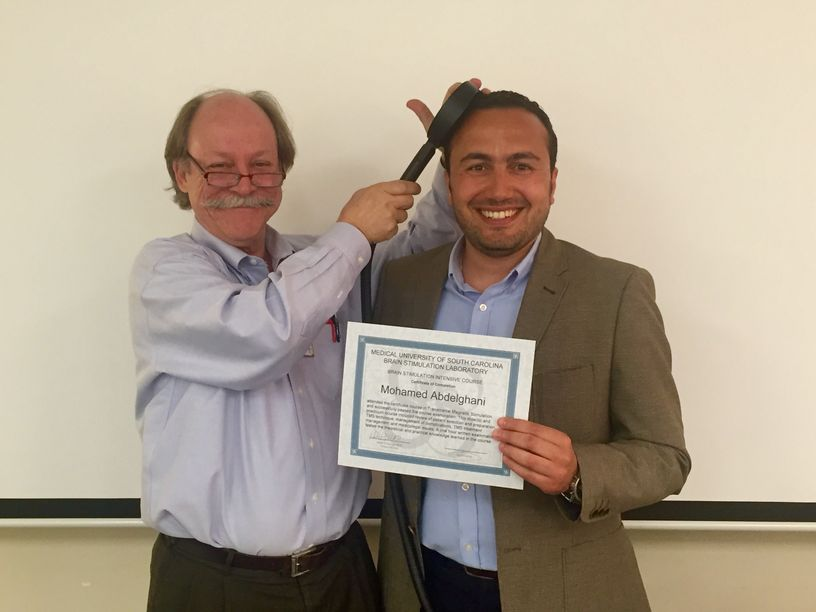 Dr Mohamed Abdelghani receiving TMS training certificate from Prof Mark George (MUSC 2016)